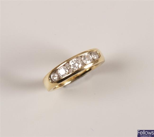 Yellow gold mounted five stone diamond half hoop