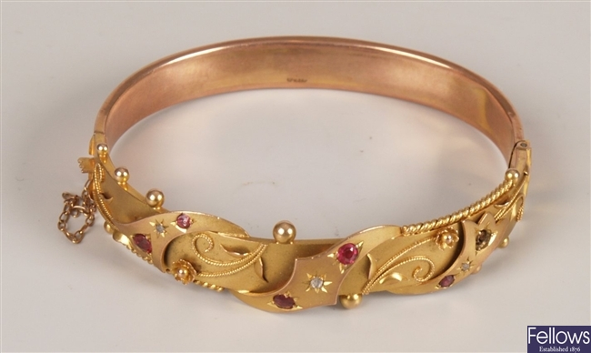 Edwardian 9ct gold ruby and diamond bangle with
