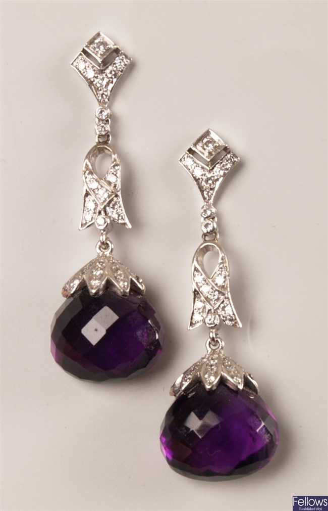 A pair of diamond and amethyst dropper earrings