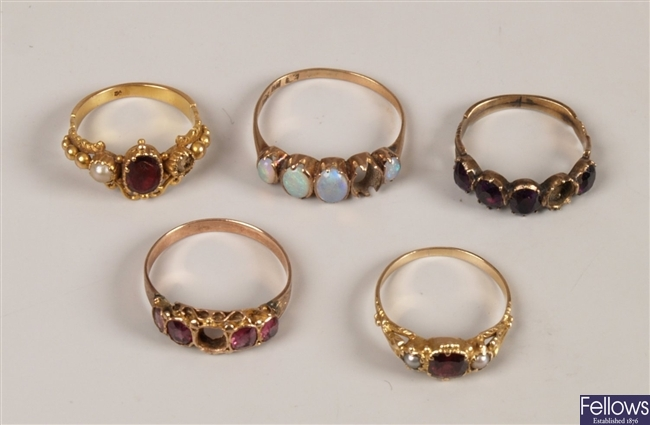 Five rings to include a 9ct gold graduated opal