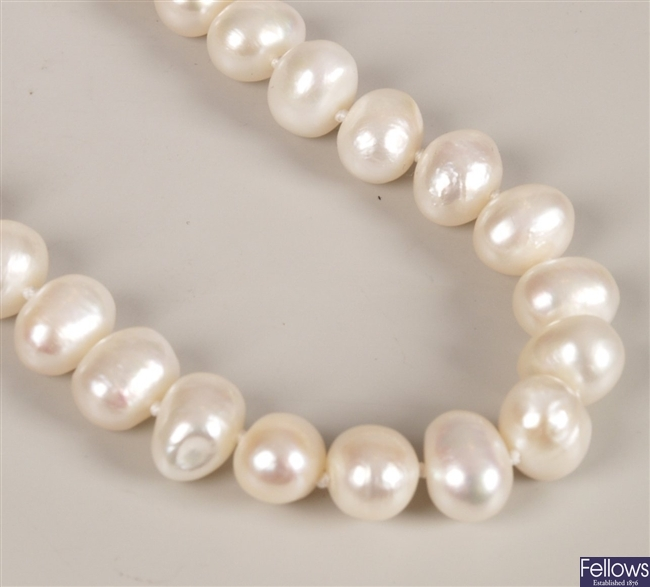 Single row of baroque pearls with an 18ct gold