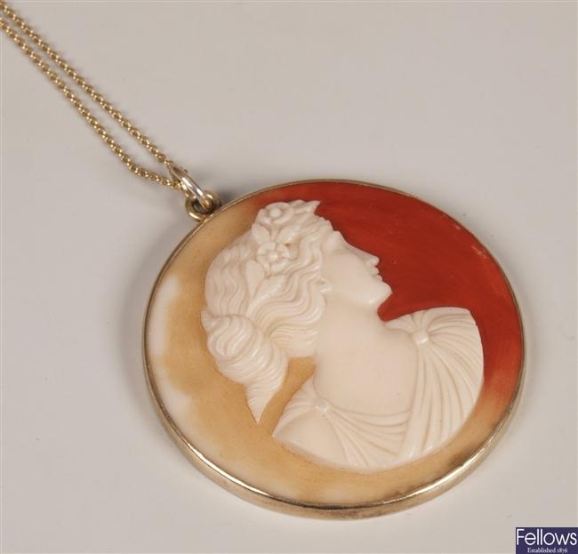 Circular stone cameo pendant depicting a young