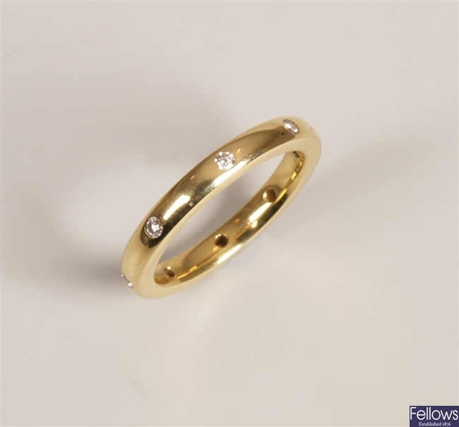 18ct gold diamond band ring with eight spaced