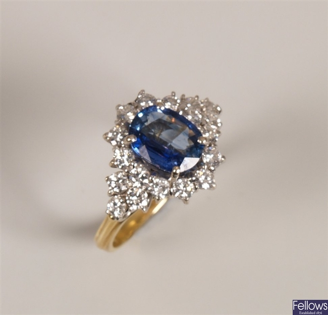 18ct gold sapphire and diamond cluster ring, a