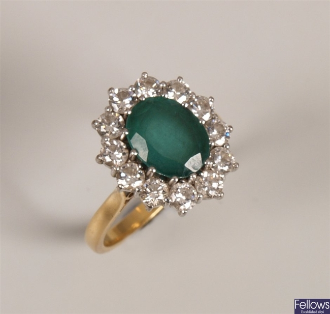 18ct gold emerald and diamond cluster ring, a