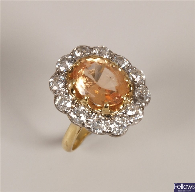 Oval yellow topaz and diamond cluster ring. with