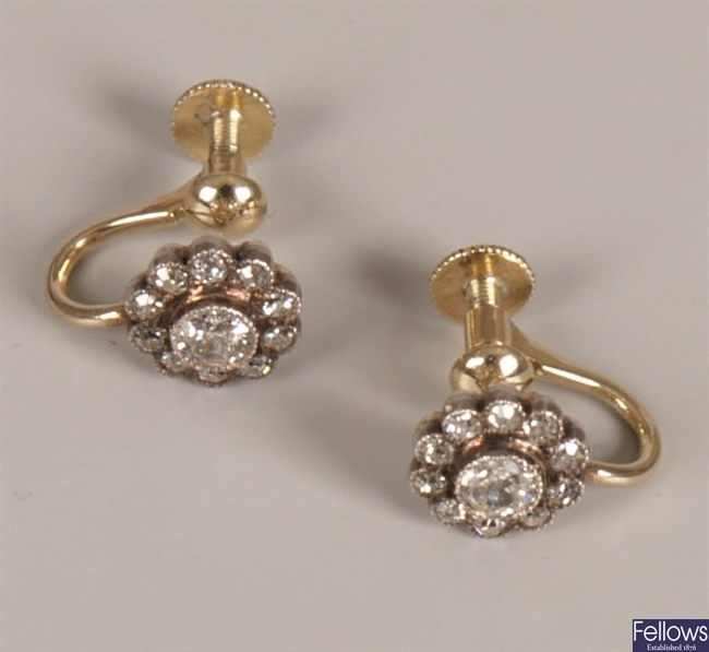 Diamond cluster stud earrings with a central old