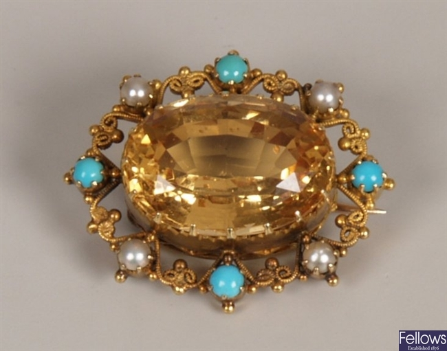 Ornate citrine set brooch, with wirework outer