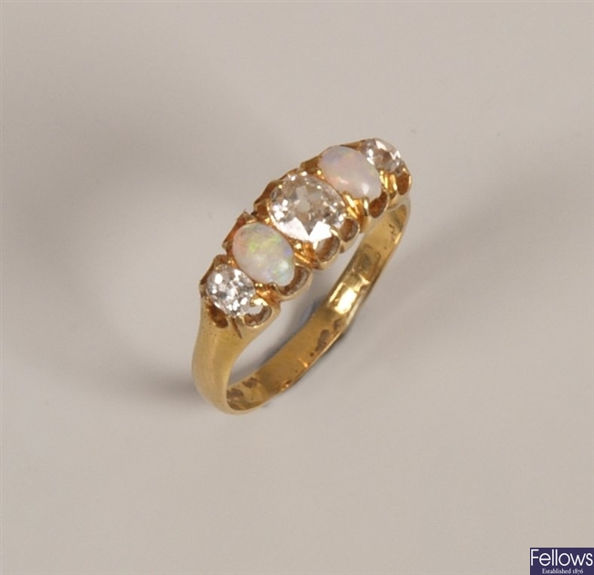 18ct gold five stone diamond and opal set ring,