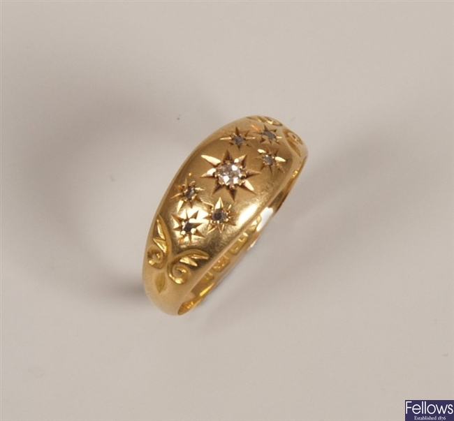 18ct gold diamond ring with a central star set
