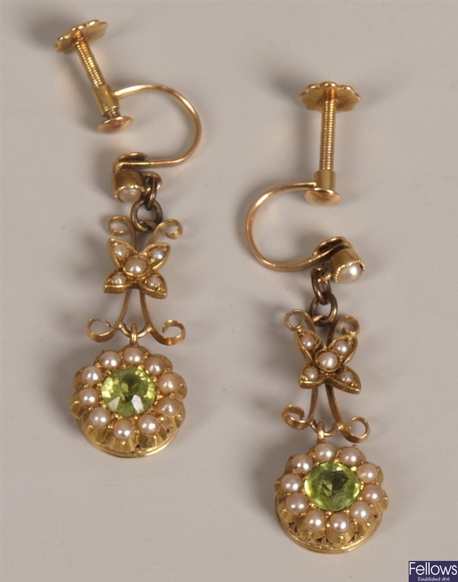 A pair of 15ct gold seed pearl and peridot set