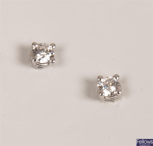 Pair of 18ct white gold claw set diamond stud