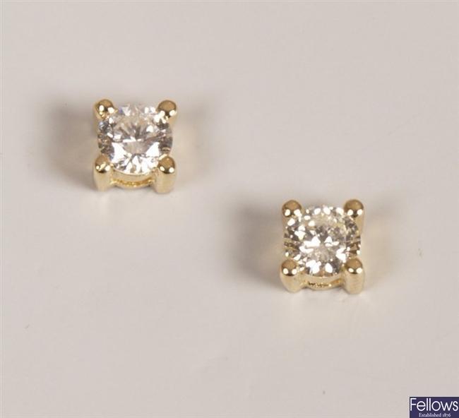 Pair of 18ct yellow gold claw set diamond stud