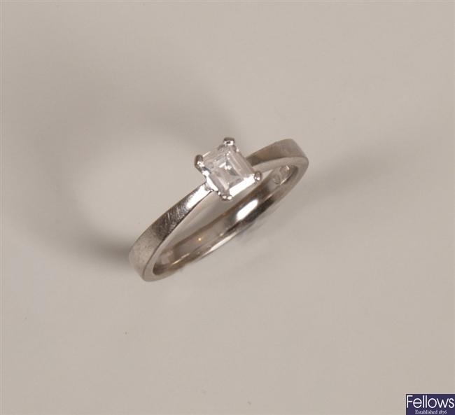 18ct white gold claw set emerald cut single stone