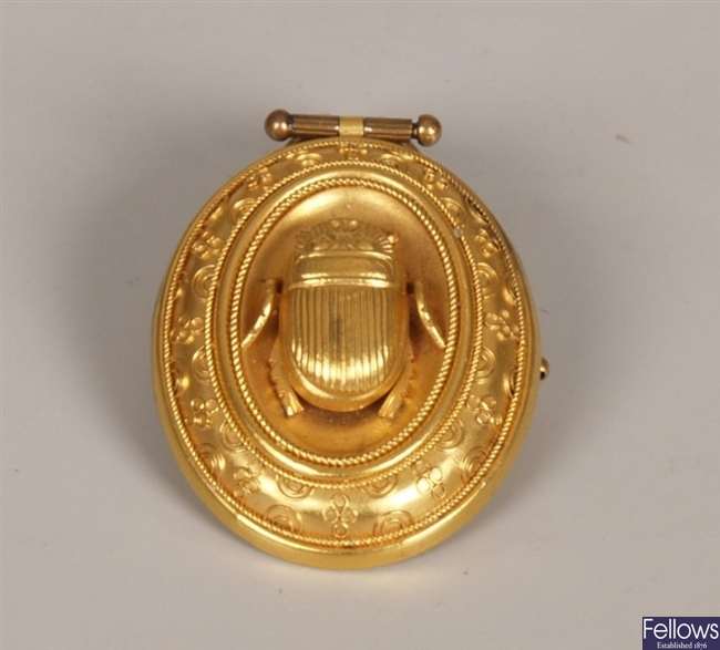 Oval pendant with central gold work scarab and