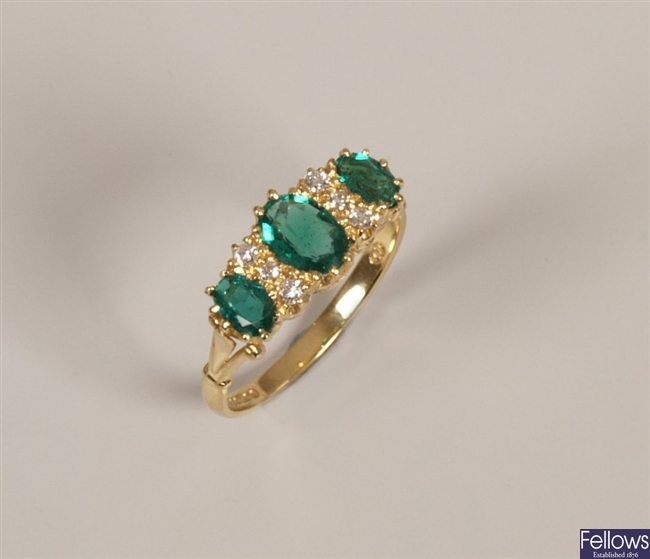 18ct gold emerald and diamond ring with three