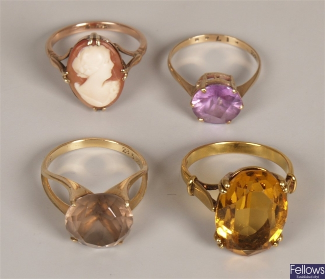 Four rings to include a 14ct gold single stone
