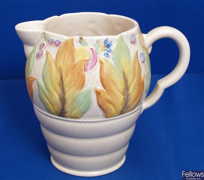 A Clarice Cliff pottery jug, moulded and painted