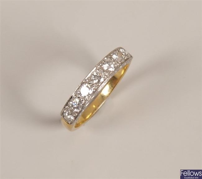 Seven stone diamond ring with pave set round