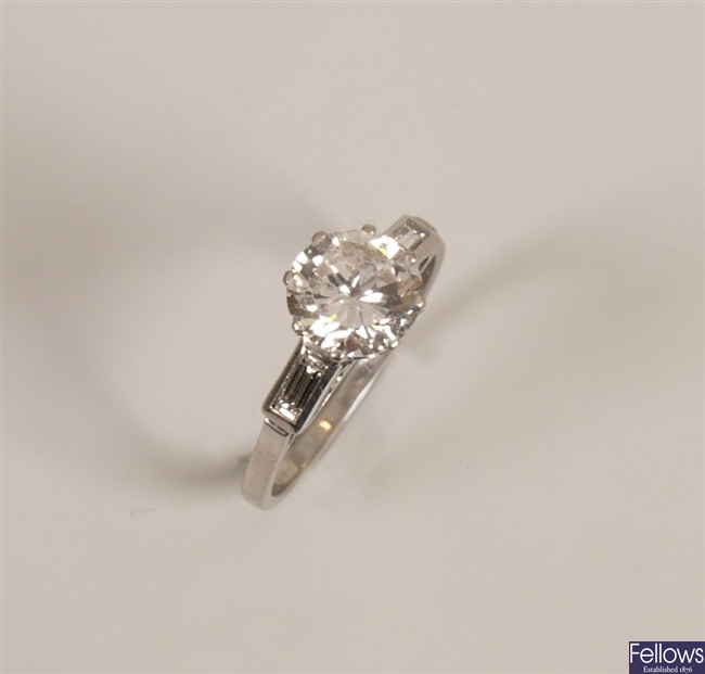 Platinum single stone diamond ring with a central