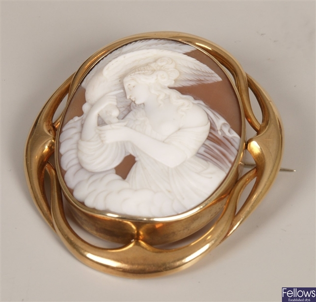 A large oval cameo brooch depicting a classical
