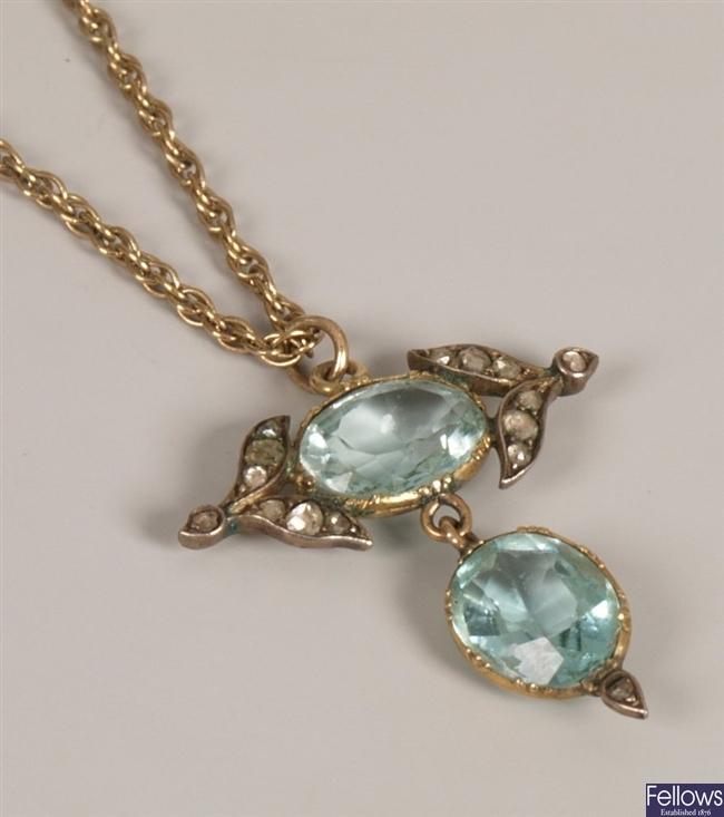 Aquamarine and diamond point set pendant, with a