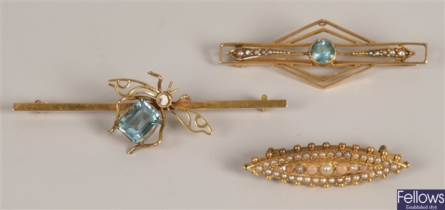 Three brooches, to include a seed pearl and coral