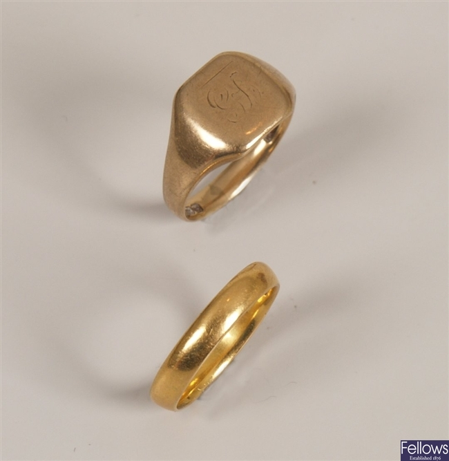 Two rings, to include a 22ct gold band ring and a