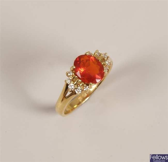 18ct gold fire opal and diamond ring with a