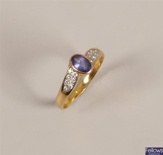 18ct gold tanzanite and diamond ring with a