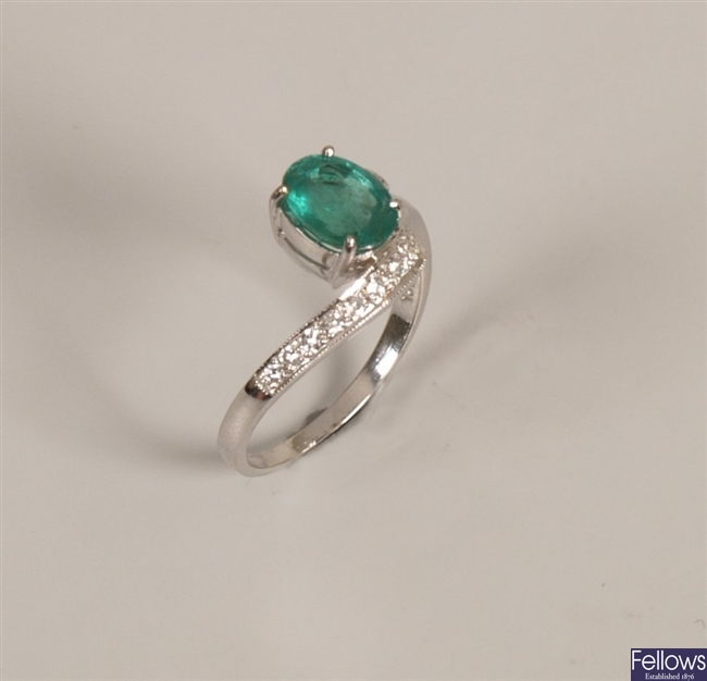 18ct white gold emerald and diamond ring with a