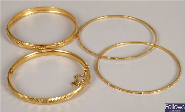 Four bangles to include a 22ct gold bangle with