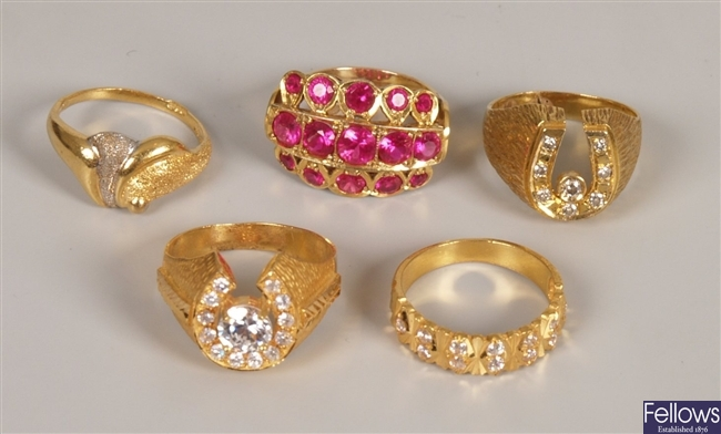 Five rings to include a round brilliant diamond
