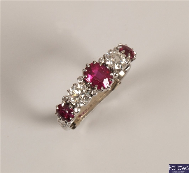 Five stone graduated ruby and diamond ring with
