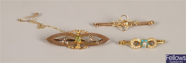 Three brooches to include a 9ct gold and peridot