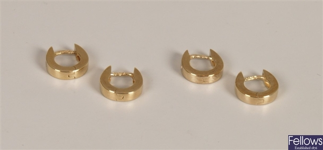 Two pairs of diamond set hoop earrings with a