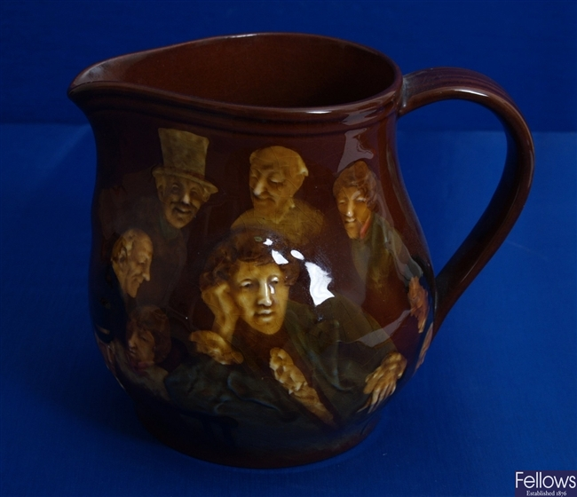 A Royal Doulton brown glazed jug with relief