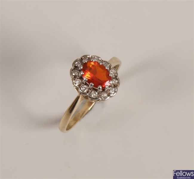 9ct gold fire opal and diamond set cluster ring,
