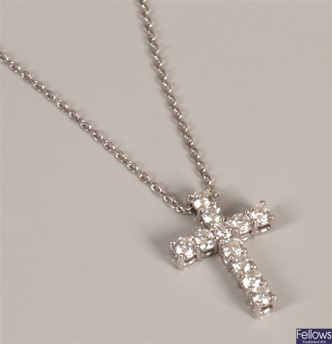 18ct white gold cross set with eleven round cut