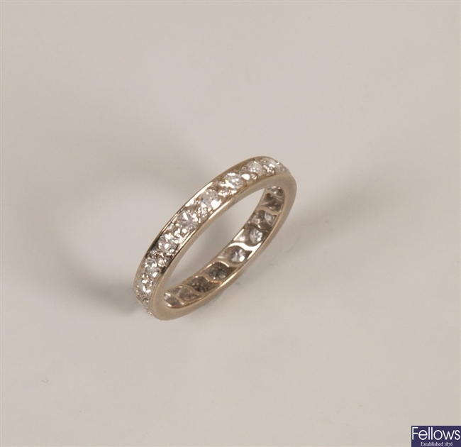 A diamond set full eternity ring - size     .