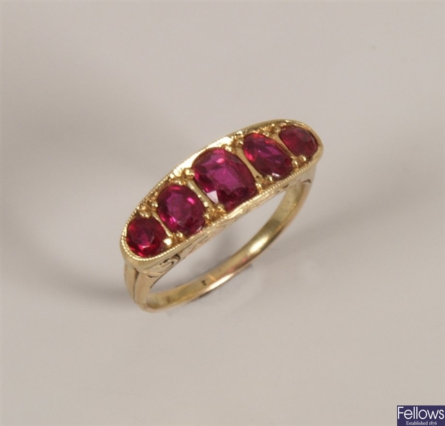 Five stone ruby ring with graduated oval rubies