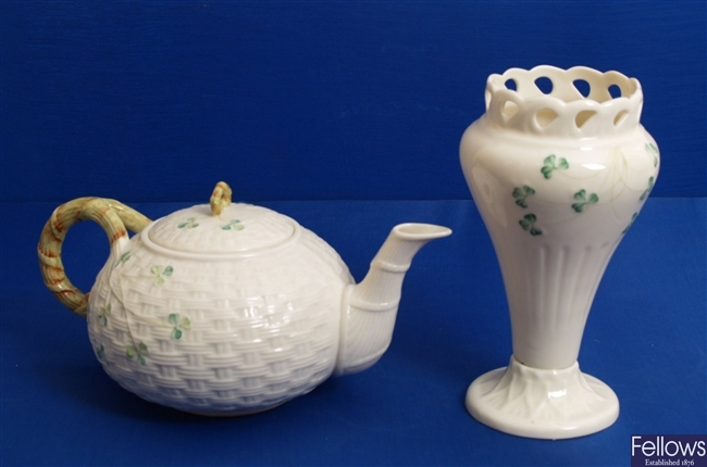 A Beleek basket moulded teapot, decorated with