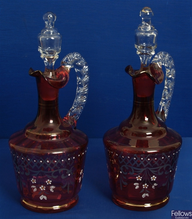 A pair of Victorian cranberry glass decanters,