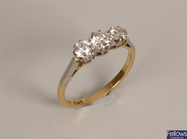 18ct gold and platinum three stone round