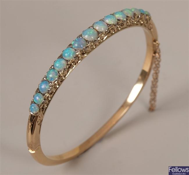Graduated opal set hinged bangle, with fifteen