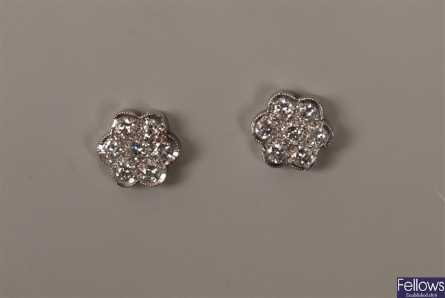 A pair of 18ct white gold seven stone round