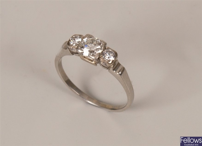 Platinum three stone graduated diamond ring set