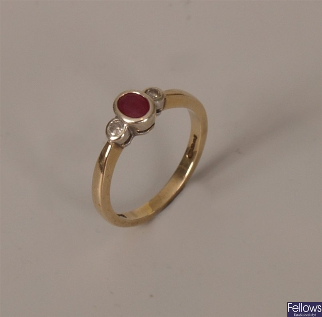 9ct gold three stone ruby and diamond ring, with