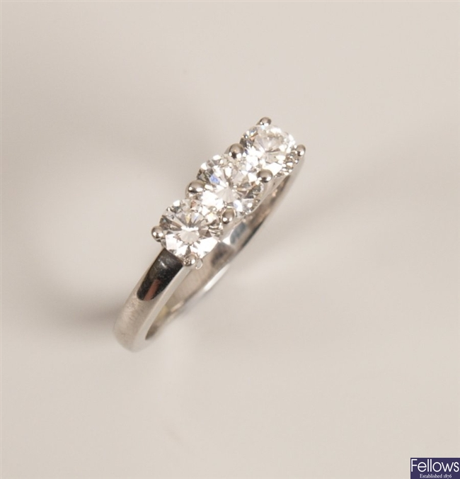 Platinum mounted three stone diamond ring - the