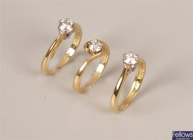 Three 18ct gold single stone diamond rings set